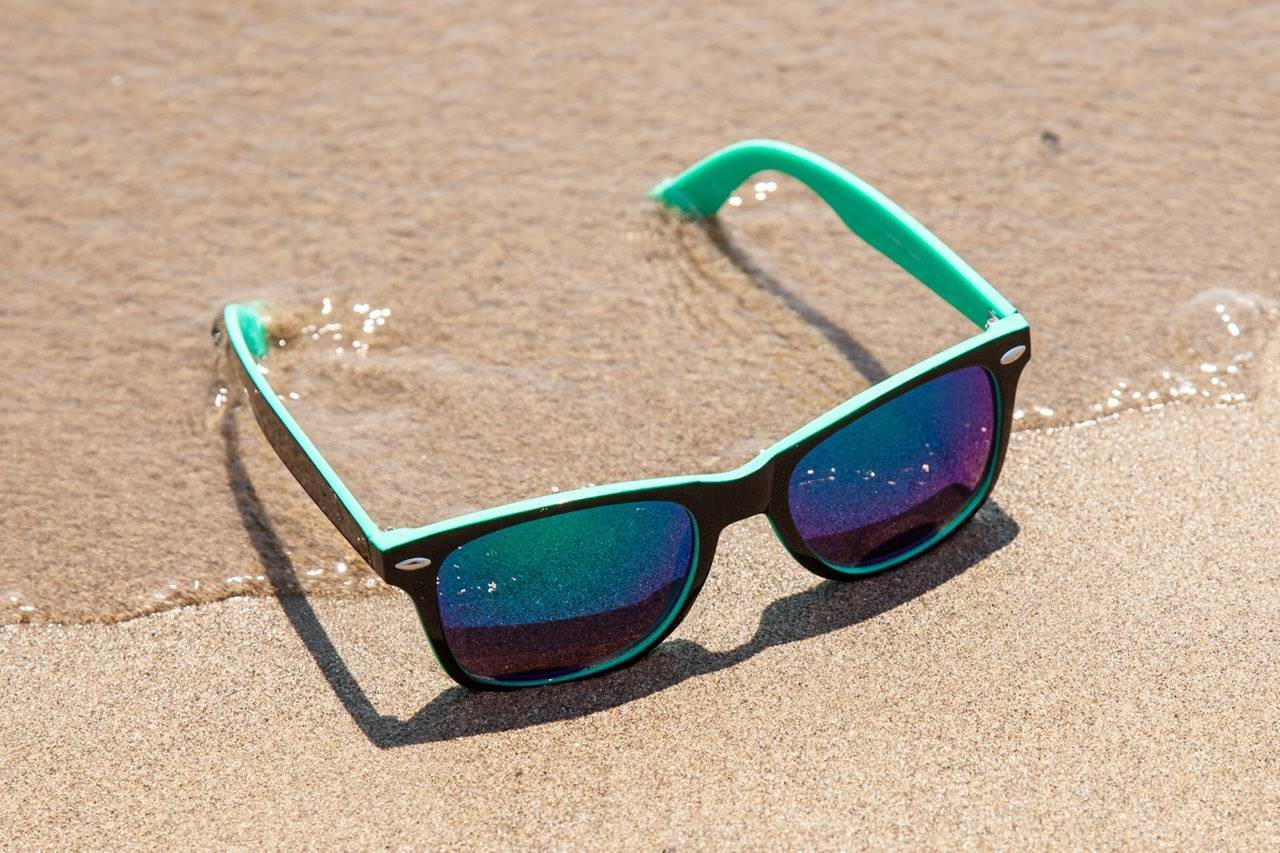 blue sunglasses sandy beach
